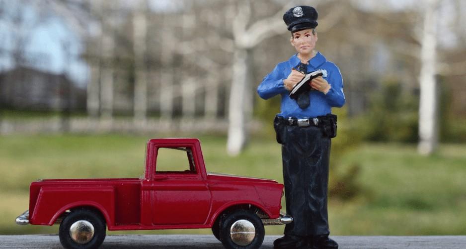 police writing traffic ticket